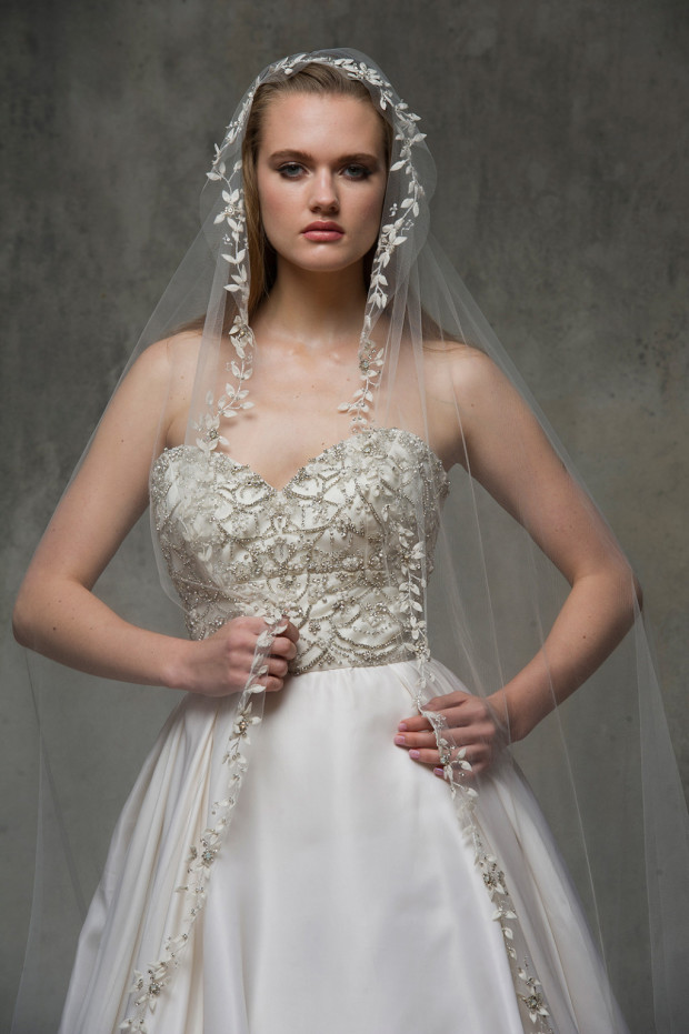 Cathedral veil with hand cut leaf-like appliques