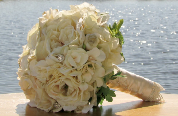 Warm ivory colored blooms and rhinestone crystals.